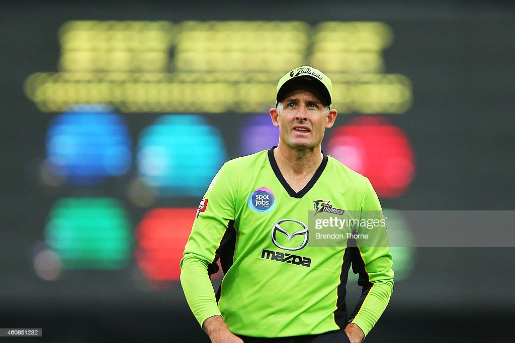 Mike Hussey of the Thunder looks on during the Big Bash League match between the Sydney Thunder and the Sydney Sixers at ANZ Stadium on December 27, 2014 in Sydney, Australia.