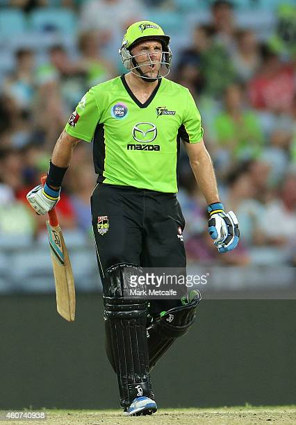 Mike Hussey of the Thunder reacts to hitting a six during the Big Bash League match between the Sydney Thunder and Brisbane Heat at ANZ Stadium on...