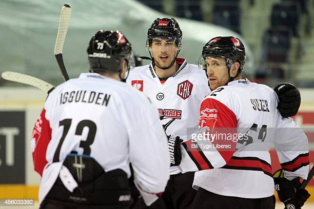 Mike Iggulden Pascal Zerressen and Alexander Sulzer of Koelner Haie celebrate a goal during the Champions Hockey League group stage game between Bili...