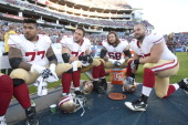 Mike Iupati Joe Staley Adam Snyder and Daniel Kilgore of the San Francisco 49ers sit on the sideline during the game against the Tennessee Titans at...