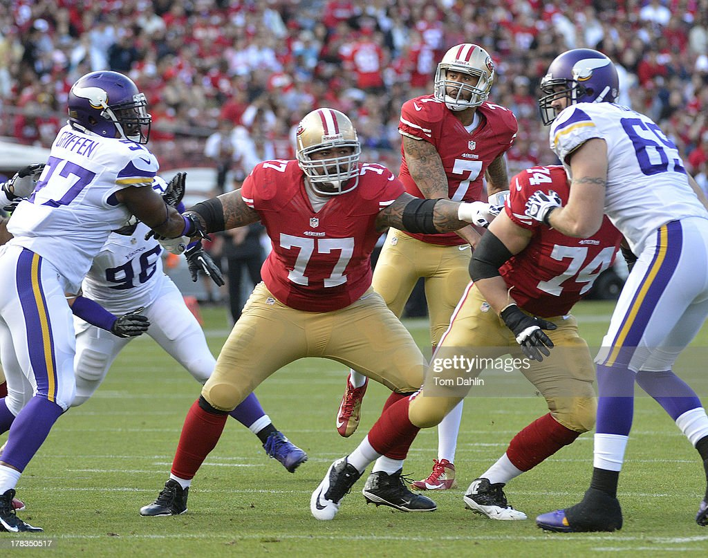 Mike Iupati #77 of the of the San Francisco 49ers blocks during a NFL game against the Minnesota Vikings, August 25, 2013, at Candlestick Park in San Francisco, California.