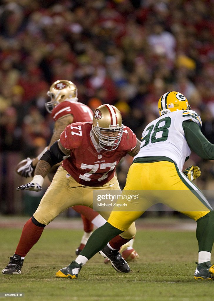Mike Iupati #77 of the San Francisco 49ers blocks during the game against the Green Bay Packers at Candlestick Park on January 12, 2012 in San Francisco, California. The 49ers defeated the Packers 45-31.