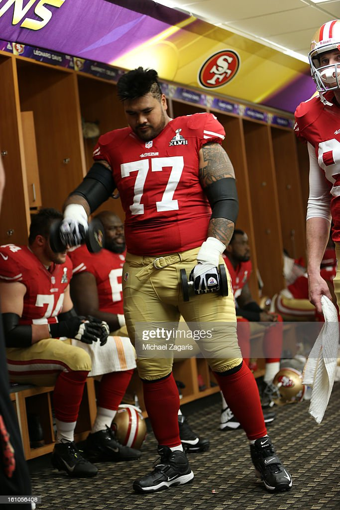 Mike Iupati #77 of the San Francisco 49ers lifts weights in the locker room prior to Super Bowl XLVII against the Baltimore Ravens at the Mercedes-Benz Superdome on February 3, 2013 in New Orleans, Louisiana. The Ravens won 34-31.