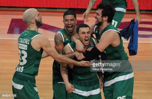 Mike James #5 of Panathinaikos Superfoods Athens scores a buzzer beater that gives his team the victory and celebrates with his teamates during the...