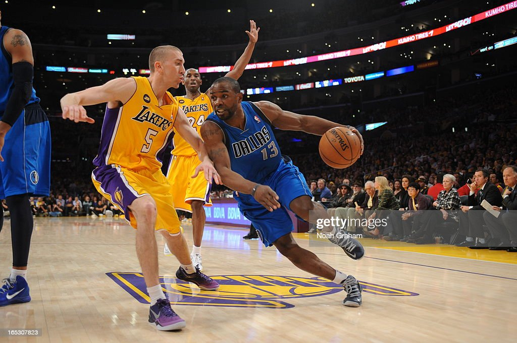 Mike James #13 dribbles against Steve Blake #5 of the Los Angeles Lakers at Staples Center on April 2, 2013 in Los Angeles, California.