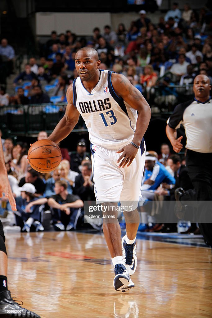 Mike James #13 of the Dallas Mavericks brings the ball up court against the New Orleans Hornets on April 17, 2013 at the American Airlines Center in Dallas, Texas.