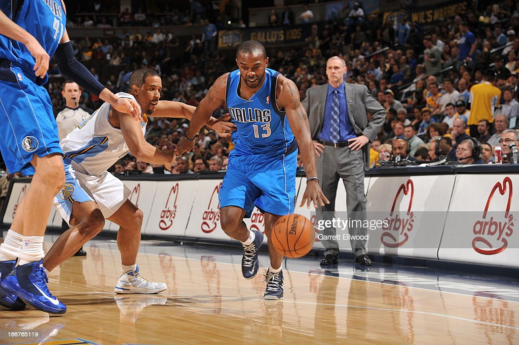 Mike James #13 of the Dallas Mavericks pushes the ball up the court against the Denver Nuggets on April 4, 2013 at the Pepsi Center in Denver, Colorado.
