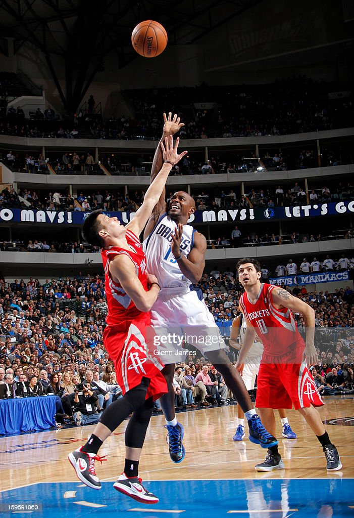 Mike James #13 of the Dallas Mavericks puts up the floater against Jeremy Lin #7 of the Houston Rockets on January 16, 2013 at the American Airlines Center in Dallas, Texas.