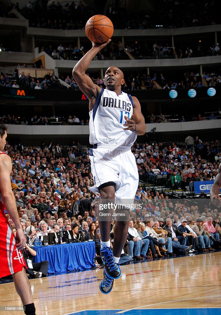 Mike James #13 of the Dallas Mavericks puts up the floater against the Houston Rockets on January 16, 2013 at the American Airlines Center in Dallas, Texas.