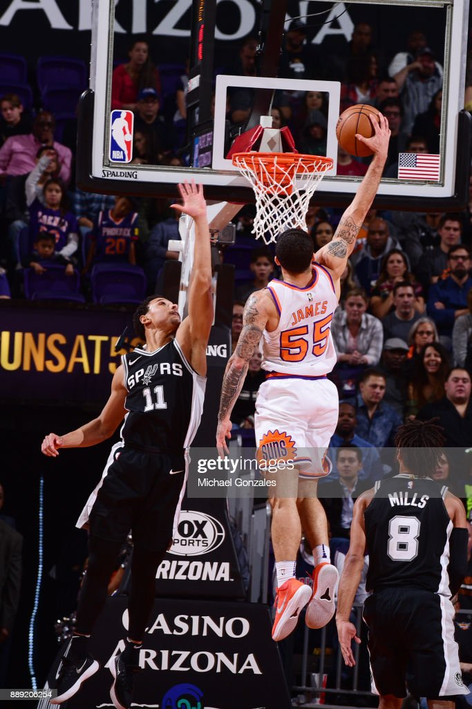 Mike James #55 of the Phoenix Suns dunks the ball against the San Antonio Spurs on December 9, 2017 at Talking Stick Resort Arena in Phoenix, Arizona.