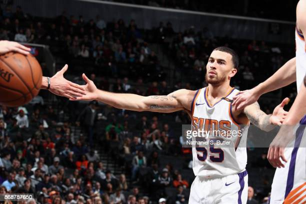 Mike James of the Phoenix Suns high fives his teammates during the game against the Brooklyn Nets on October 31 2017 at Barclays Center in Brooklyn...