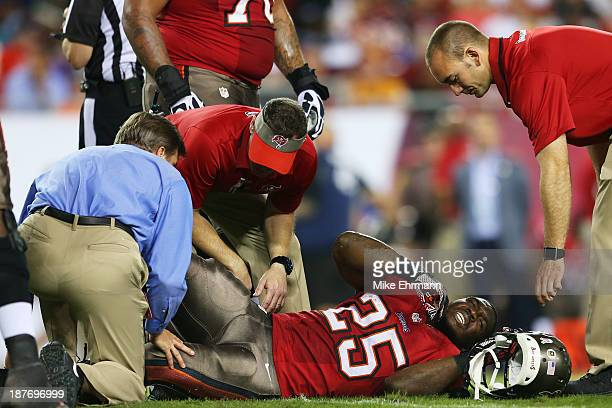 Mike James of the Tampa Bay Buccaneers receives medical attention after being injured in the first quarter against the Miami Dolphins at Raymond...