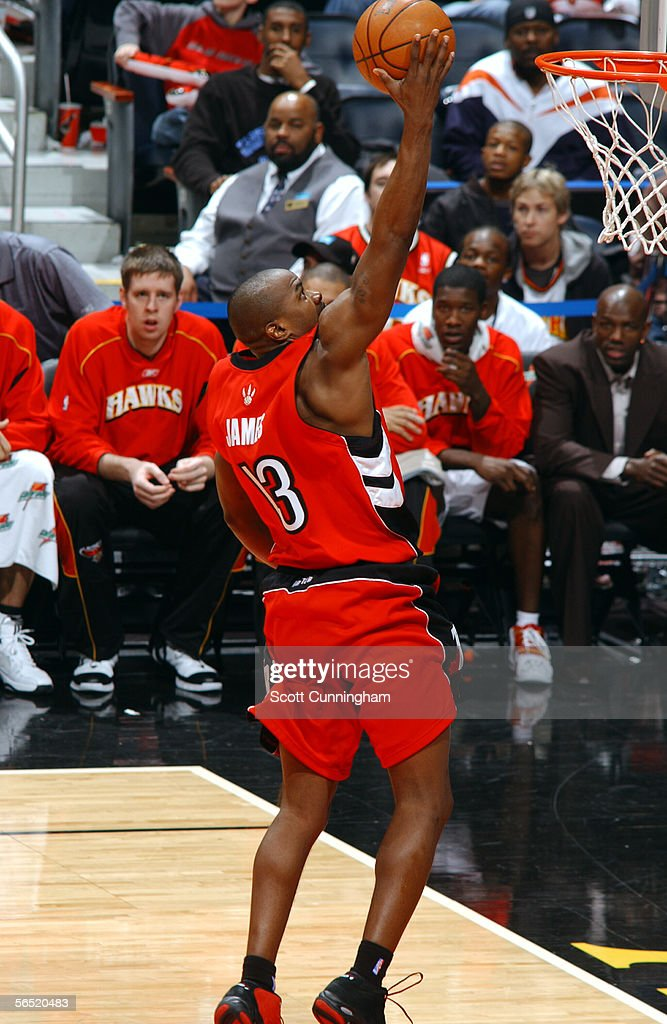 Mike James of the Toronto Raptors drives to the basket against the Atlanta Hawks during a game on January 3 2006 at Philips Arena in Atlanta Georgia...