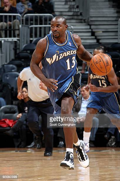 Mike James of the Washington Wizards brings the ball upcourt against the Atlanta Hawks during the preseason game on October 19 2009 at Philips Arena...