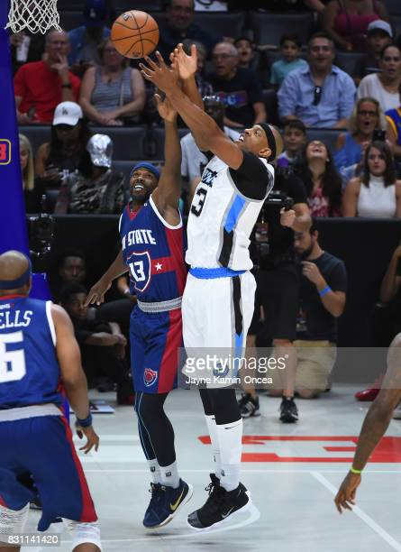 Mike James of TriState and Jerome Williams of Power go for a rebound during week eight of the BIG3 three on three basketball league at Staples Center...