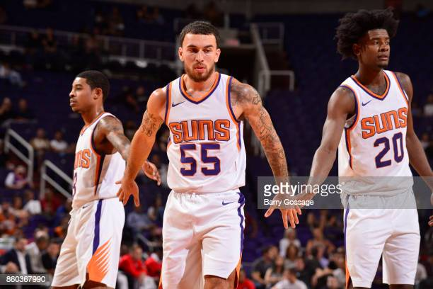 Mike James Tyler Ulis and Josh Jackson of the Phoenix Suns shake hands during the preseason game against the Portland Trail Blazers on October 11...