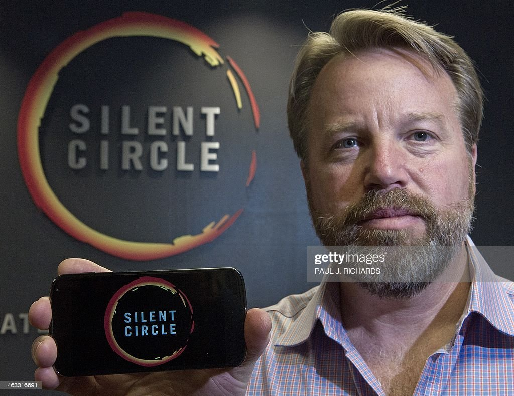 Mike Janke, CEO & Co-Founder of Silent Circle, makers of encrypted communications providing secure multiplatform communication services for mobile devices, desktop and email, holds a typical smart phone similar in styling to a new encrypted smartphone called, 'The Blackphone', Silent Circle will be selling soon, seen here, January 16, 2014, at his National Harbor, Maryland office. The actual Blackphone that Silent Circle will be selling is under wraps until it's official release date and will cost about what a unlocked Samsung Galaxy S4 or unlocked IPhone typically costs. AFP PHOTO/Paul J. Richards