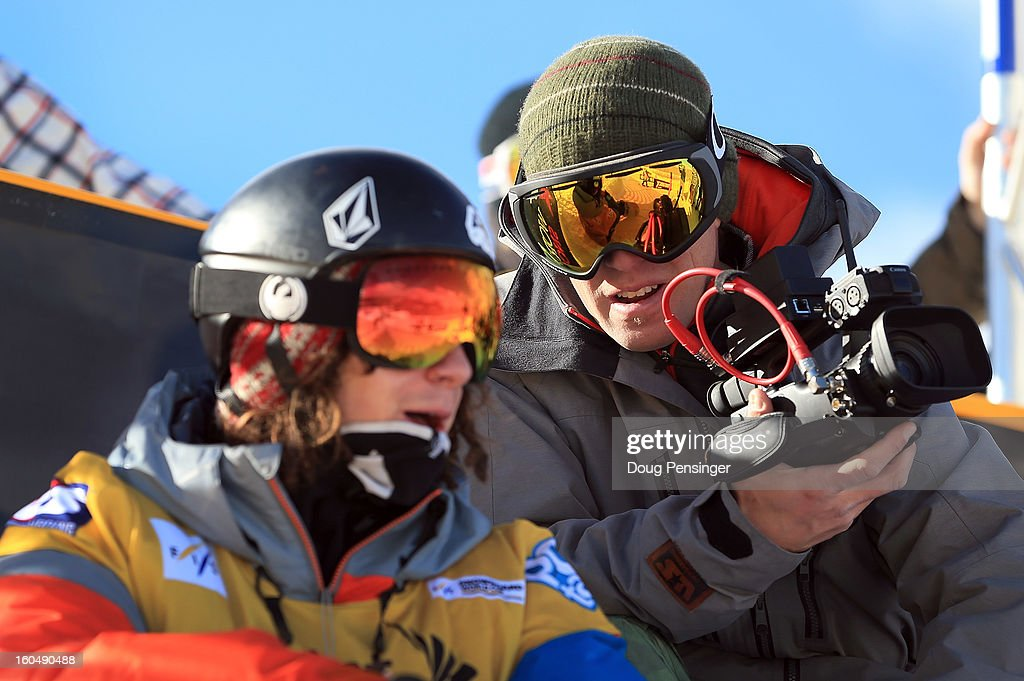 Mike Jankowski (R) Head Coach of the US Snowboarding & US Freeskiing Halfpipe & Slopestyle Team talks with Luke Mitrani (L) during practice as he finished third in the FIS Snowboard Halfpipe World Cup at the Sprint U.S. Grand Prix at Park City Mountain on February 1, 2013 in Park City, Utah.