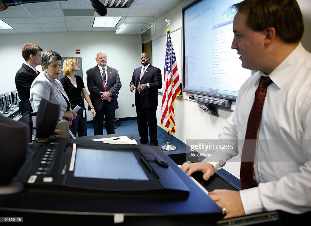 Mike Jedrey (R), a special agent of the Virginia State Police, demonstrates his chats with possible child exploitation offenders through instant messaging during U.S. Secretary of Homeland Security <a gi-track='captionPersonalityLinkClicked' href=/galleries/search?phrase=Janet+Napolitano&family=editorial&specificpeople=589781 ng-click='$event.stopPropagation()'>Janet Napolitano</a>'s (L) visit to the Cyber Crimes Center of the U.S. Immigration and Customs Enforcement October 13, 2009 in Fairfax, Virginia. The Cyber Crime Center, which is formed with the Child Exploitation Section, the Computer Forensics Section and the Cyber Crimes Section, focus on investigating criminal activities occur on or facilitated by the Internet. It also offers training to local, federal, and international law enforcement agencies.