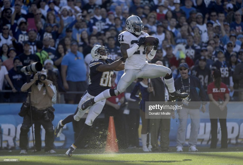 Mike Jenkins #21 of the Oakland Raiders intercepts the ball in front of Vincent Brown #86 of the San Diego Chargers against on December 22, 2013 at Qualcomm Stadium in San Diego, California.