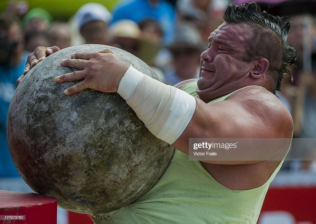 Mike Jenkins of USA competes at the Atlas Stones event during the World's Strongest Man competition at Yalong Bay Cultural Square on August 24, 2013 in Hainan Island, China.