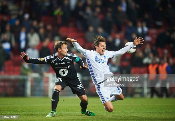 Mike Jensen of Rosenborg BK and Uros Matic of FC Copenhagen compete for the ball during the preseason friendly match between FC Copenhagen and...