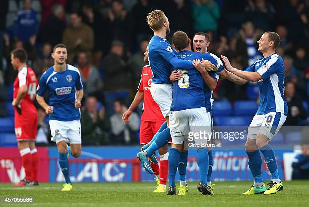 Mike Jones of Oldham Athletic celebrates with team mates after scoring the winning goal during the Sky Bet League One match between Oldham Athletic...