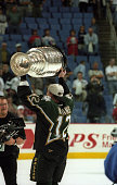 Mike Keane of the Dallas Stars celebrates with the Stanley Cup after the Stars defeated the Buffalo Sabres in Game 6 of the 1999 Stanley Cup Finals...