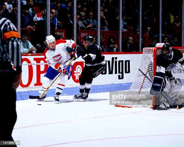 Mike Keane of the Montreal Canadiens skates against left wing Tony Granato and goaltender Daniel Berthiaume of the Los Angeles Kings in a game at the...
