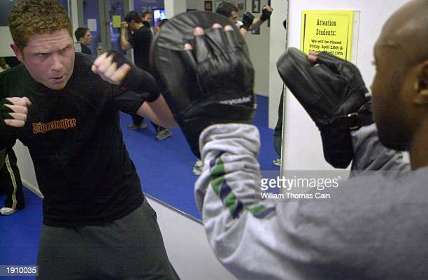 Mike Kenny defends himself against Devon Mayo in a Krav Maga class April 9 2003 in Philadelphia Pennsylvania With the US at high terror alert there...