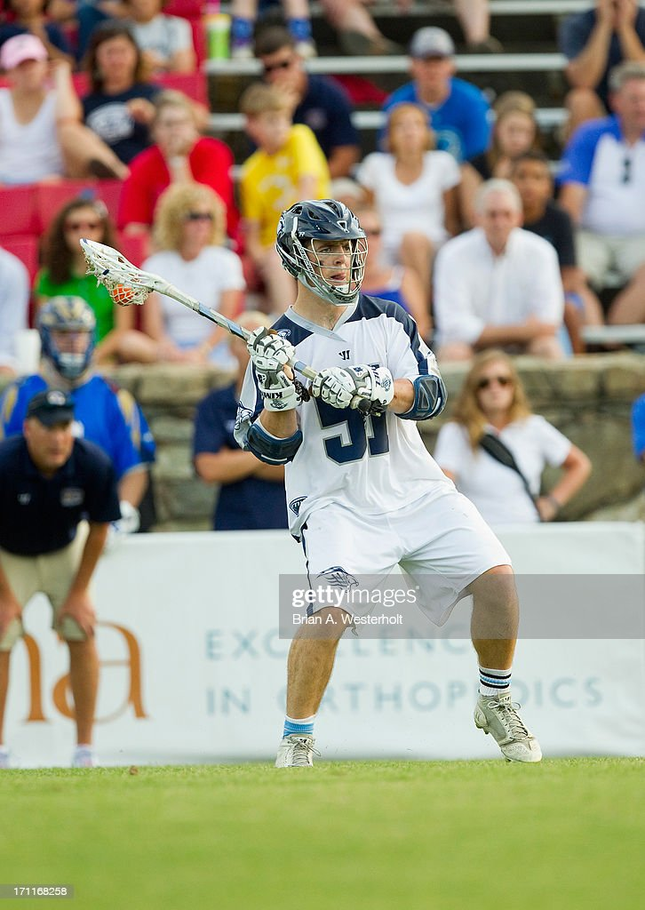 Mike Kimmel #51 of the Chesapeake Bayhawks looks for an open teammate to pass the ball to during the game against the Charlotte Hounds at American Legion Memorial Stadium on June 22, 2013 in Charlotte, North Carolina. The Hounds defeated the Bayhawks 16-15 in overtime.