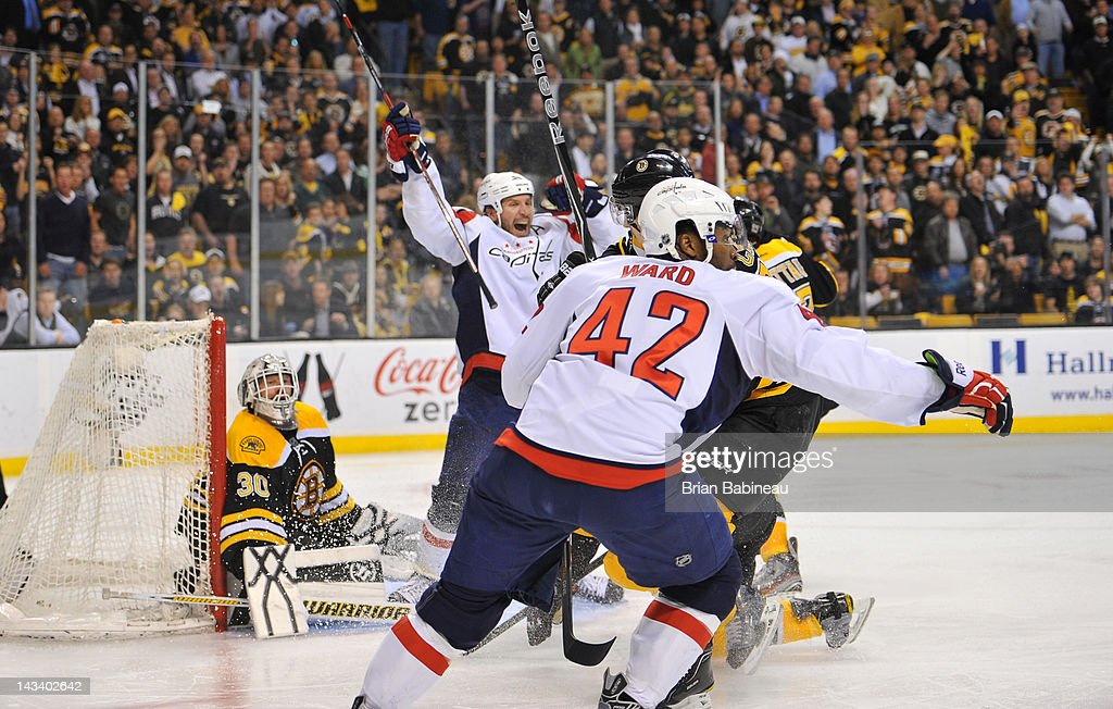 Mike Knuble #22 and Joel Ward #42 of the Washington Capitals celebrate a win in overtime against the Boston Bruins in Game Seven of the Eastern Conference Quarterfinals during the 2012 NHL Stanley Cup Playoffs at TD Garden on April 25, 2012 in Boston, Massachusetts.