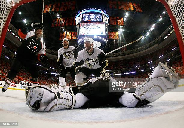 Mike Knuble of the Philadelphia Flyers celebrates as goaltender MarcAndre Fleury of the Pittsburgh Penguins lies flat on the ice after allowing a...