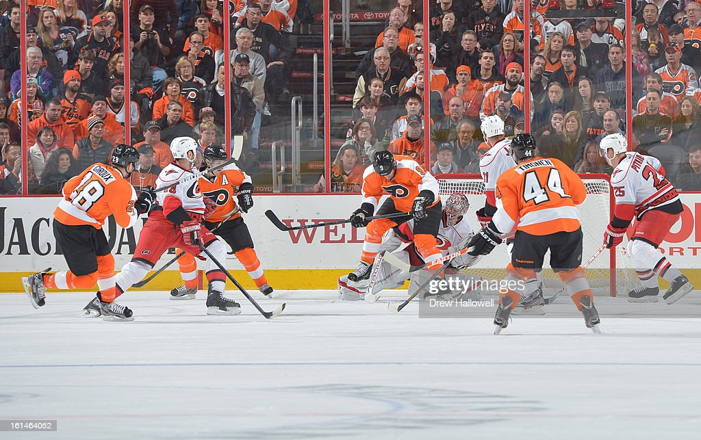 Mike Knuble #9 of the Philadelphia Flyers puts pressure on Cam Ward #30 of the Carolina Hurricanes at the Wells Fargo Center on February 9, 2013 in Philadelphia, Pennsylvania.