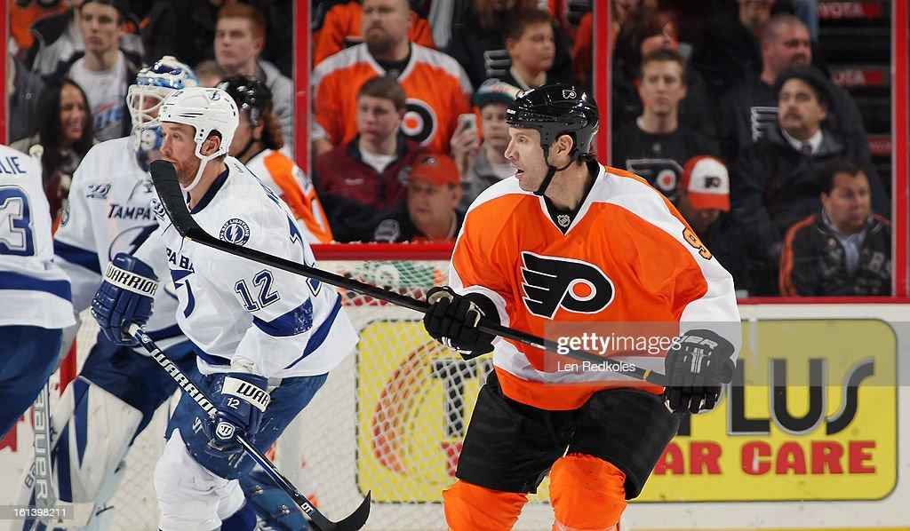 Mike Knuble #9 of the Philadelphia Flyers skates against Ryan Malone #12 of the Tampa Bay Lightning on February 5, 2013 at the Wells Fargo Center in Philadelphia, Pennsylvania.