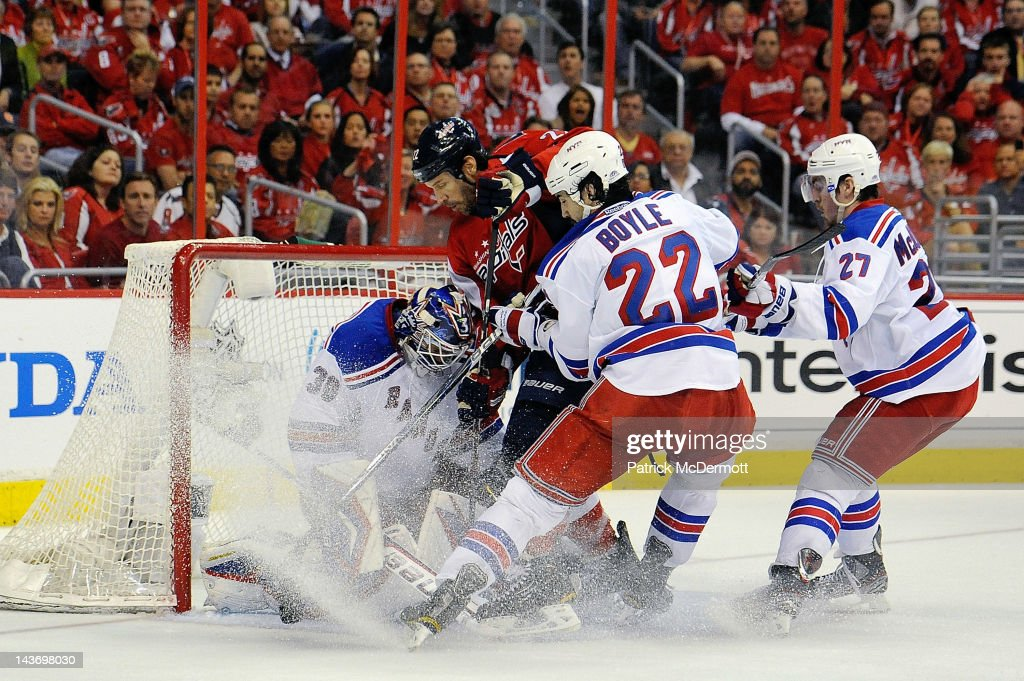 Mike Knuble #22 of the Washington Capitals battles with Henrik Lundqvist #30, Brian Boyle #22, and Ryan McDonagh #27 of the New York Rangers in front of the net during the third period in Game Three of the Eastern Conference Semifinals during the 2012 NHL Stanley Cup Playoffs at the Verizon Center on May 2, 2012 in Washington, DC.