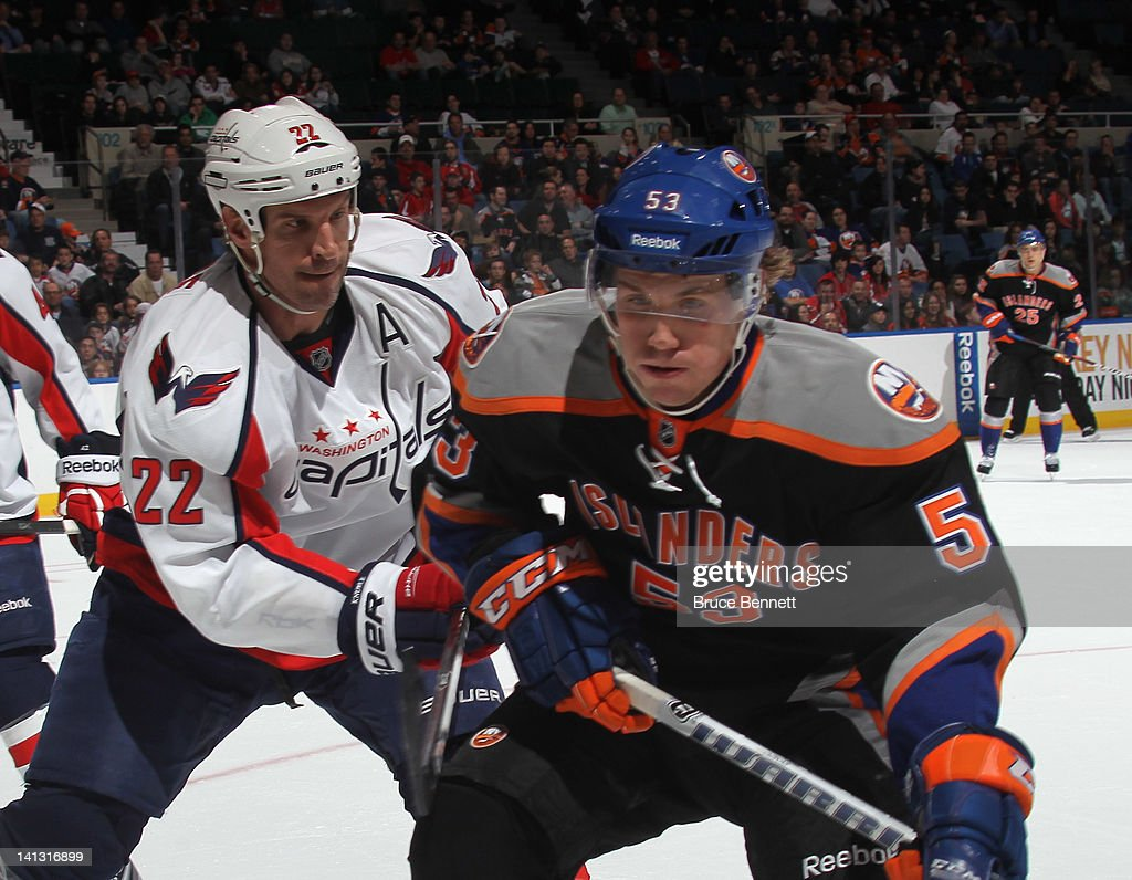 <a gi-track='captionPersonalityLinkClicked' href=/galleries/search?phrase=Mike+Knuble&family=editorial&specificpeople=202077 ng-click='$event.stopPropagation()'>Mike Knuble</a> #22 of the Washington Capitals checks Casey Cizikas #53 of the New York Islanders at the Nassau Veterans Memorial Coliseum on March 13, 2012 in Uniondale, New York.