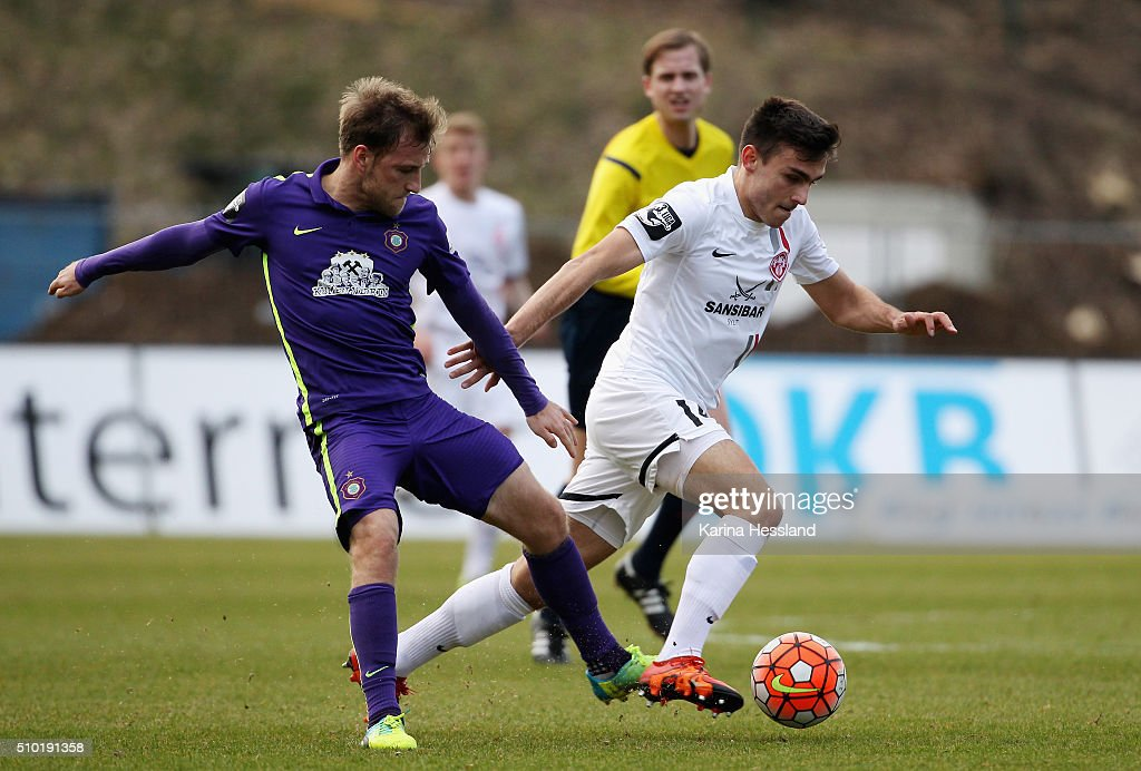 Mike Koennecke of Aue challenges Ioannis Karsanidis of Wuerzburg during the Third League match between FC Erzgebirge Aue and Wuerzburger Kickers at Erzgebirgsstadium on February 14, 2016 in Aue, Germany.