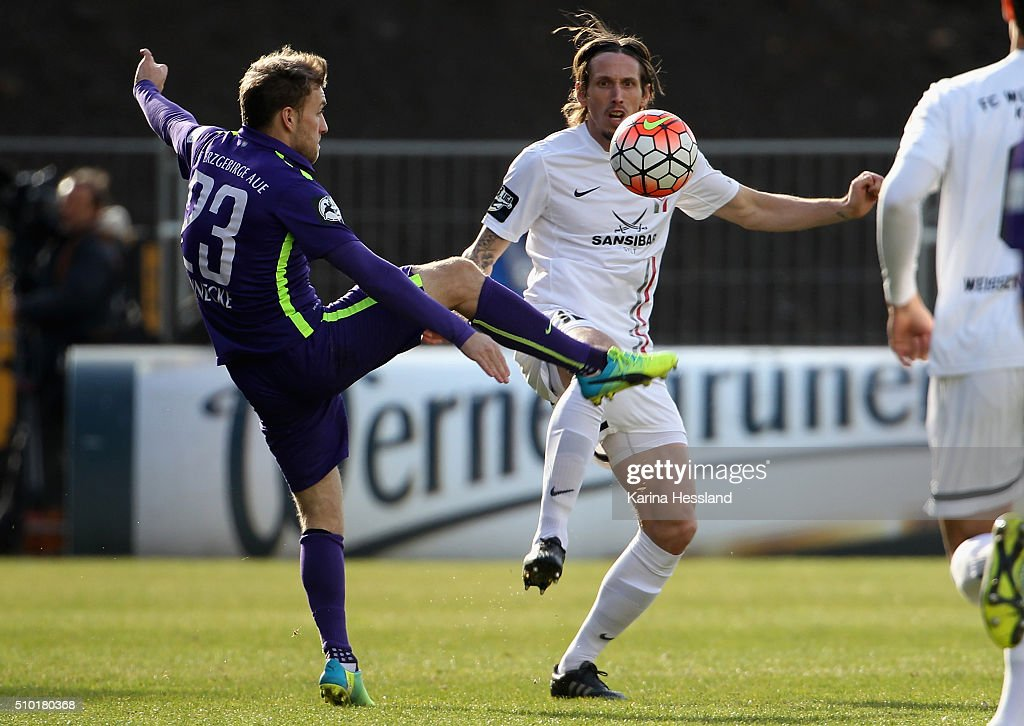 Mike Koennecke of Aue challenges Lukas Billick of Wuerzburg during the Third League match between FC Erzgebirge Aue and Wuerzburger Kickers at Erzgebirgsstadium on February 14, 2016 in Aue, Germany.