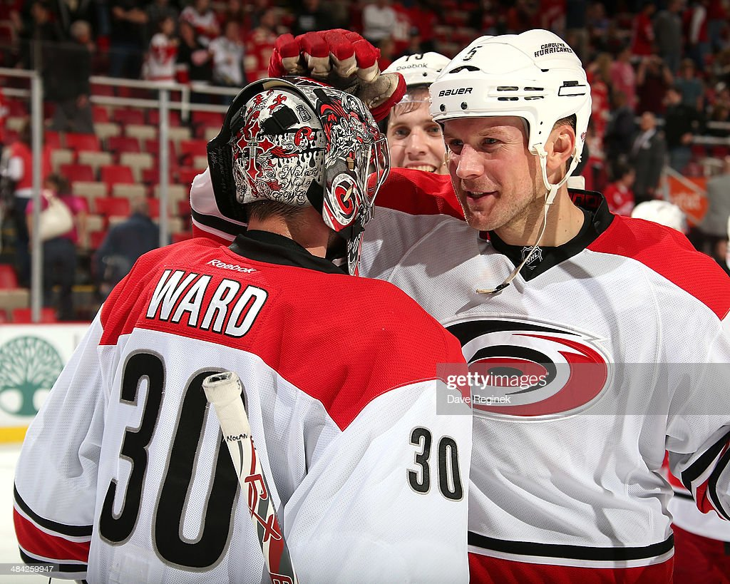 <a gi-track='captionPersonalityLinkClicked' href=/galleries/search?phrase=Mike+Komisarek&family=editorial&specificpeople=213814 ng-click='$event.stopPropagation()'>Mike Komisarek</a> #5 of the Carolina Hurricanes congratulates teammate <a gi-track='captionPersonalityLinkClicked' href=/galleries/search?phrase=Cam+Ward&family=editorial&specificpeople=453216 ng-click='$event.stopPropagation()'>Cam Ward</a> #30 after an NHL game against the Detroit Red Wings on April 11, 2014 at Joe Louis Arena in Detroit, Michigan. Carolina defeated Detroit 2-1