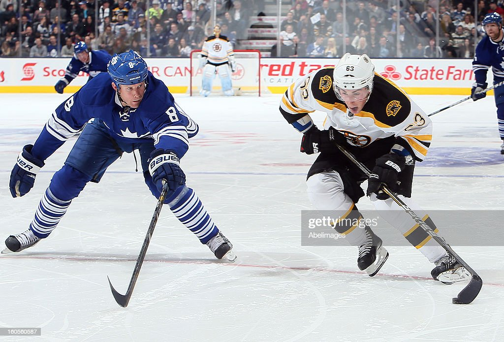 Mike Komisarek #8 of the Toronto Maple Leafs tries to stop Brad Marchand #63 of the Boston Bruins during NHL action at the Air Canada Centre February 2, 2013 in Toronto, Ontario, Canada.