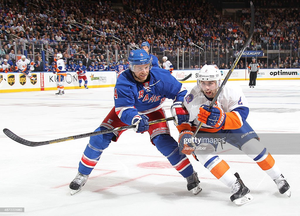 <a gi-track='captionPersonalityLinkClicked' href=/galleries/search?phrase=Mike+Kostka&family=editorial&specificpeople=2193393 ng-click='$event.stopPropagation()'>Mike Kostka</a> #4 of the New York Rangers and <a gi-track='captionPersonalityLinkClicked' href=/galleries/search?phrase=Nick+Leddy&family=editorial&specificpeople=5894600 ng-click='$event.stopPropagation()'>Nick Leddy</a> #2 of the New York Islanders battle for puck at Madison Square Garden on October 14, 2014 in New York City.