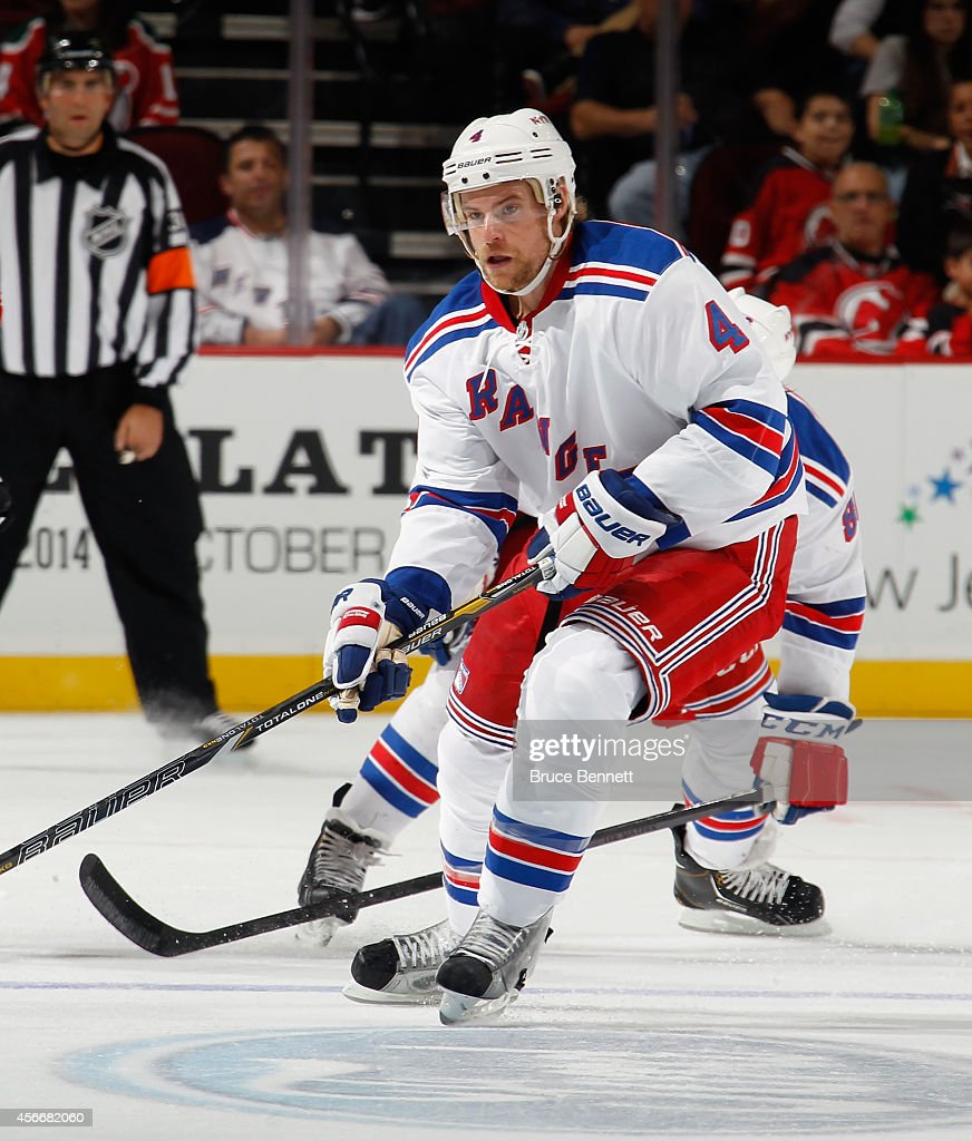 <a gi-track='captionPersonalityLinkClicked' href=/galleries/search?phrase=Mike+Kostka&family=editorial&specificpeople=2193393 ng-click='$event.stopPropagation()'>Mike Kostka</a> #4 of the New York Rangers skates against the New Jersey Devils at the Prudential Center on October 4, 2014 in Newark, New Jersey. The Devils shutout the Rangers 3-0.