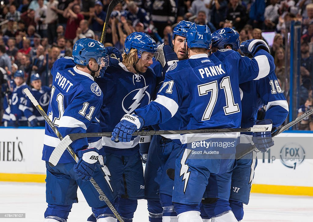 Mike Kostka #21 of the Tampa Bay Lightning celebrates his goal with teammates Tom Pyatt #11 and Richard Panik #71 during the first period against the Florida Panthers at the Tampa Bay Times Forum on March 13, 2014 in Tampa, Florida.