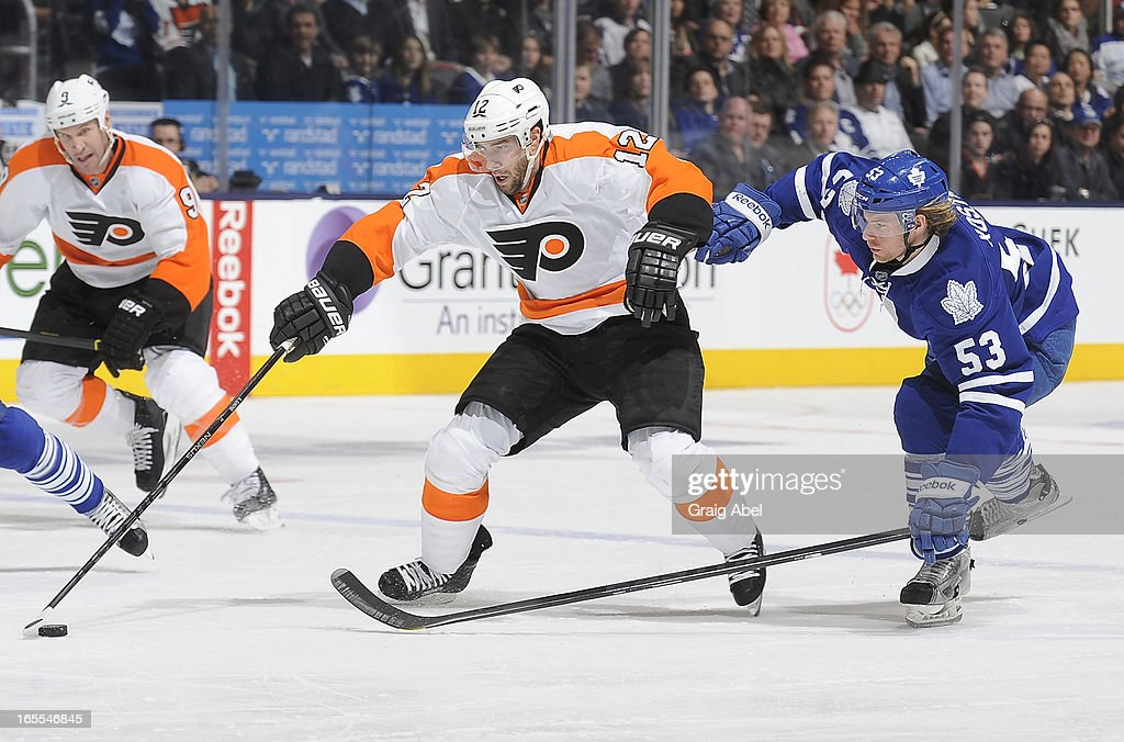 Mike Kostka #53 of the Toronto Maple Leafs battles for the puck with <a gi-track='captionPersonalityLinkClicked' href=/galleries/search?phrase=Simon+Gagne&family=editorial&specificpeople=201772 ng-click='$event.stopPropagation()'>Simon Gagne</a> #12 of the Philadelphia Flyers during NHL game action April 4, 2013 at the Air Canada Centre in Toronto, Ontario, Canada.