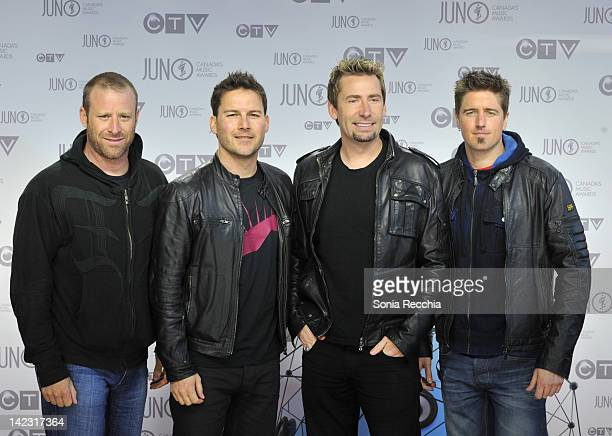 Mike Kroeger Ryan Peake Chad Kroeger and Daniel Adair members of Nickelback poses on the red carpet at the 2012 JUNO Awards at Scotiabank Place on...