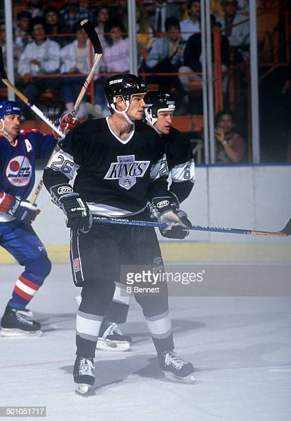 Mike Krushelnyski of the Los Angeles Kings skates on the ice during an NHL game against the Winnipeg Jets circa 1990 at the Great Western Forum in...