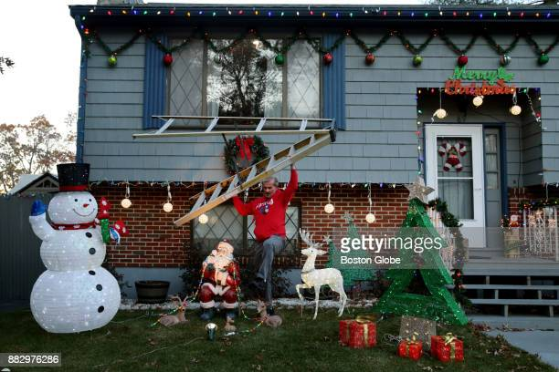 Mike Kwiatek puts the finishing touches on his holiday decorations at his home in Lynn MA on Nov 28 2017