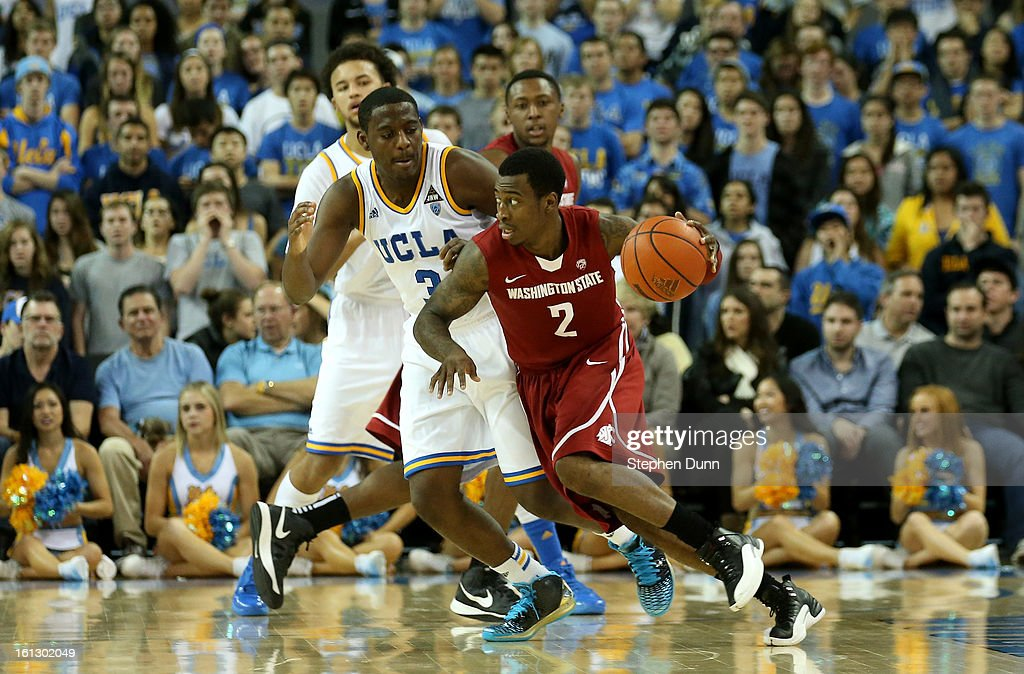 Mike Ladd #2 of the Washington State Cougars drives around Jordam Adams #3 of the UCLA Bruins at Pauley Pavilion on February 9, 2013 in Los Angeles, California. UCLA won 76-62.