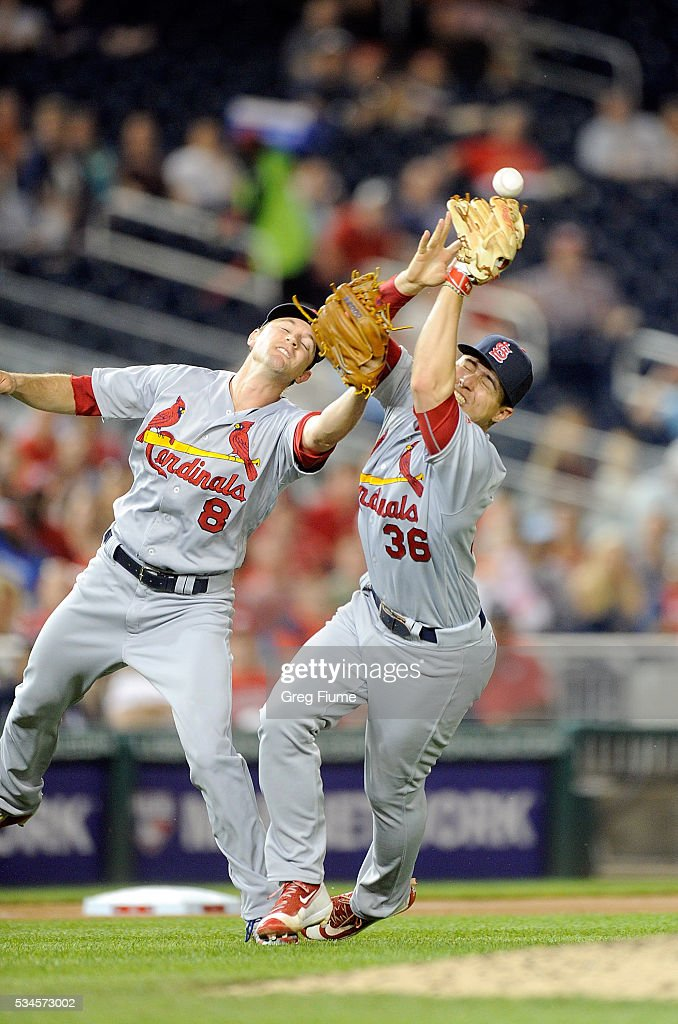 Mike Leake and Aledmys Diaz of the St Louis Cardinals collide trying to catch a pop fly in the seventh inning against the Washington Nationals at...